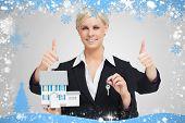 Composite image of multitasking estate agent against snow