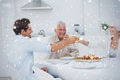Composite image of Family clinking their glasses of white wine against snow
