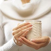 stock photo of nail-design  - Woman holds a winter cup close up - JPG