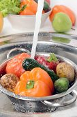 stock photo of mixing faucet  - Washing fruits and vegetables close - JPG