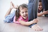 picture of mischief  - Playful girls holding father - JPG