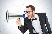 Geeky businessman shouting through megaphone against twinkling stars
