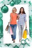 Two cheerful friends with shopping bags against christmas frame