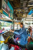 CHIANG RAI, THAILAND - JANUARY 10: Unidentified driver of an old Thai bus, January 10, 2014 on Chiang Rai.