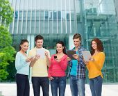 friendship, technology, education, business and people concept - group of smiling teenagers with sma poster