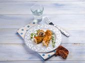 stock photo of swordfish  - breaded swordfish stuffed with dried tomatoes - JPG