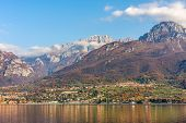 Mountains and small town on the shores of Lake Como in Italy.