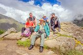 MACHU PICCHU, PERU - MAY 3, 2014 - group of tourists after climbing Huayna Picchu mountain