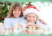 Composite image of adorable childrens celebrating christmas against green snowflake design