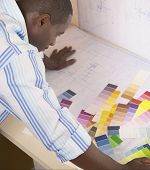 Male architect viewing color swatches
