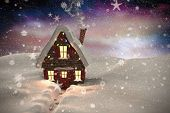 Composite image of christmas house against aurora night sky in purple