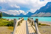 Majestic mountain lake and small wooden bridge in Canada.