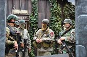 MUSKOGEE, OK - Sept. 13: Soldiers dressed in camouflage are ready to hunt zombies during the Castle