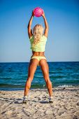 foto of volleyball  - Beach woman in bikini holding a volleyball - JPG