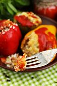 Fork with piece of stuffed pepper, close-up