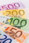 many different euro bills. symbol photo for wealth and investment.