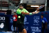 SEPTEMBER 23, 2014 - KUALA LUMPUR, MALAYSIA: Marinko Matosevic of Australia makes a backhand return in his first round match at the Malaysian Open Tennis 2014. This is an ATP sanctioned tournament.