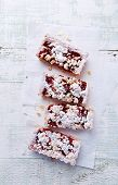 Shortcrust plum cake with coconut crumble