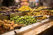 Olives on sale/display in a food market/grocery store