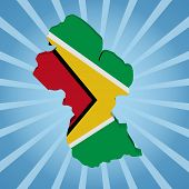 Guyana map flag on blue sunburst illustration