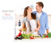 Happy Couple Cooking Together - Man and Woman in their Kitchen at home Preparing Dinner - Vegetable Salad. Diet. Dieting. Healthy vegetarian food, vegan. Family cooking together at home