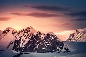 Beautiful snow-capped mountains against the sunset sky in Antarctica