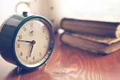 pic of analogy  - analog retro alarm clock on wooden table - JPG