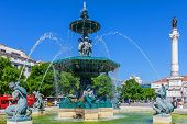 Lisbon, Portugal. August 31, 2014: Close-up on one of the two fountains of the Dom Pedro IV Square, better known as Rossio. Dom Pedro IV monument, the Dona Maria II National Theatre in background