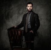 Handsome well-dressed  standing leather chair