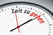 An image of a typical clock with text time to spend in german language