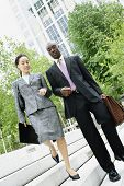 picture of descending  - Businesspeople descending steps together - JPG