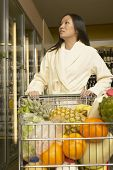 Asian woman at grocery store in bathrobe