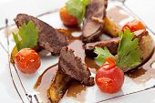 picture of duck breast  - Breast of Duck with Roasted Potato Slice and Cherry Tomatoes - JPG