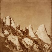 Toned image of Montserrat mountain in grunge and retro style.