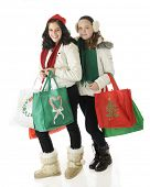 Two tween going Christmas shopping