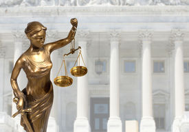 picture of metal sculpture  - Justice statue is on against the courthouse  - JPG
