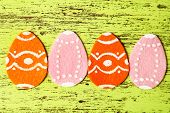 Felt Easter eggs on colorful wooden background