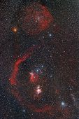 stock photo of perseus  - Red nebula in the night starry sky during summer - JPG