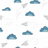 Paper airplanes on the sky with clouds