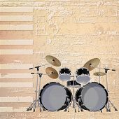 pic of drum-kit  - abstract beige grunge piano background with black drum kit - JPG