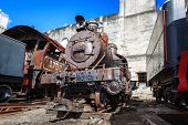 old steam locomotives on wall background