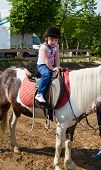image of horse girl  - an Horse and lovely baby girl equestrian - JPG