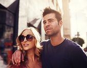 couple together in down town LA shot with lens flare and creative color filtering