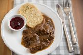 stock photo of deer meat  - deer meat in wine sauce and home made dumplings - JPG