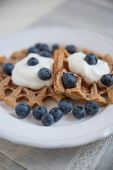 Waffle with blueberries and clotted cream