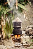 pic of boiling water  - Pot boiling water for cooking sticky rice on the fired stove - JPG