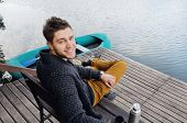 pic of pier a lake  - handsome attractive man on the wooden pier at the lake on beautiful nature background relax concept - JPG