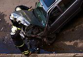 Firemen Checking Crashed Car