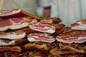 picture of pork belly  - Cured Bacon Stack Smoked and Preserved Pork Meat is Considered a Delicacy Food in Some Cultures selective focus - JPG