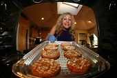 Hot and Fresh COOKIES right from the oven!  A lady bakes cookies for a charity bake sale to help raise money for a homeless dog rescue group